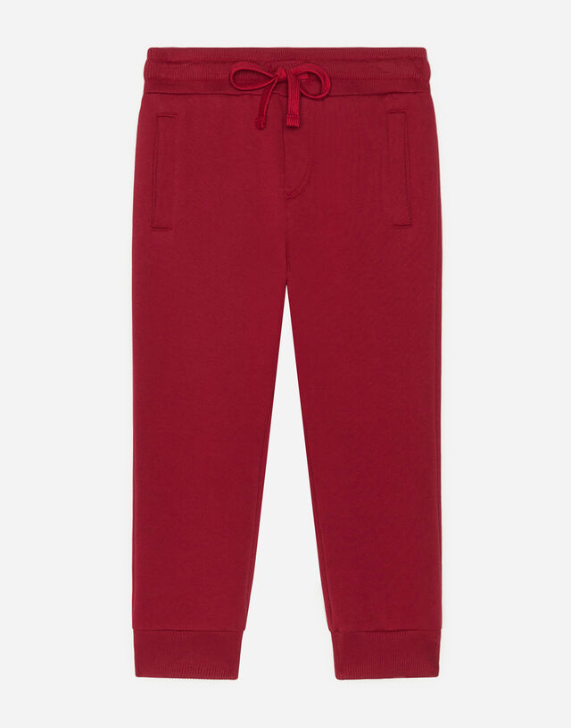 Jersey jogging pants with logo tag in Red