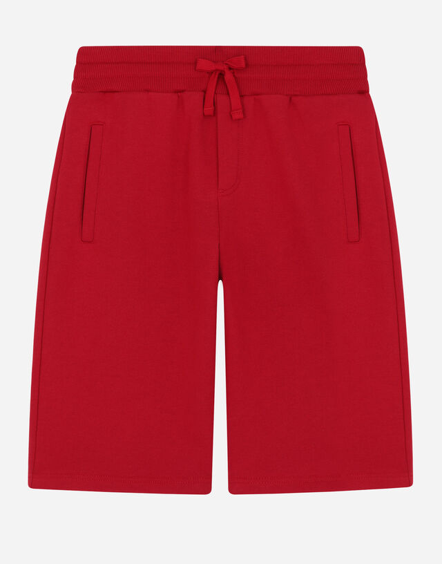 Jersey jogging shorts with logo plate in Red
