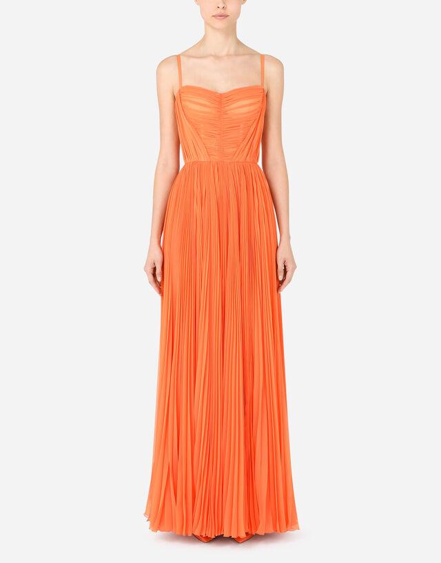 Long sleeveless chiffon dress with sunray pleats in Orange