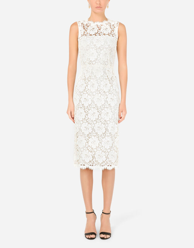 Laminated lace calf-length dress in White