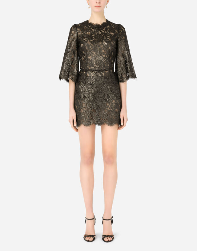 Short laminated lace dress in Black