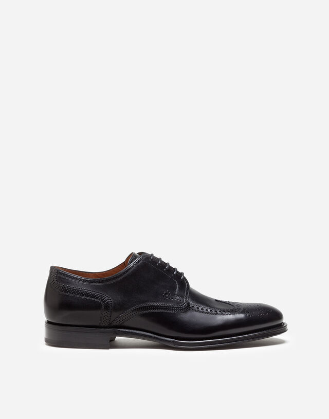 Brogue derby in giotto paint calfskin in BLACK