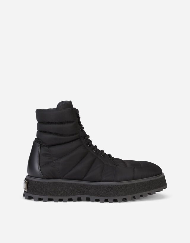Quilted nylon ankle boots with branded plate in Black