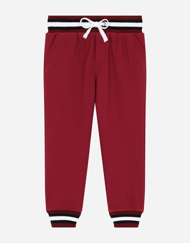 Jersey jogging pants with logo print in Red