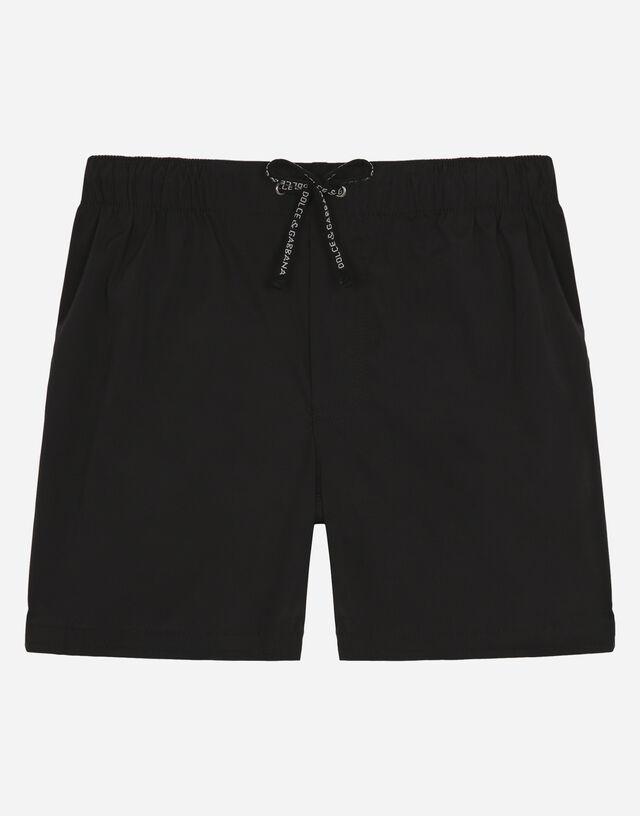 Nylon swim shorts with all-over logo print in Black