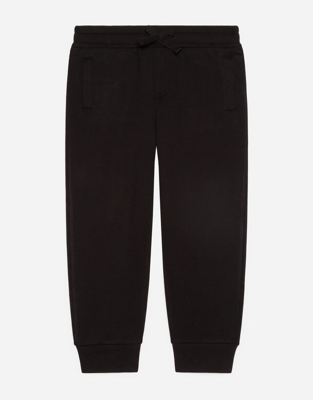 Jersey jogging pants with logo tag in Black