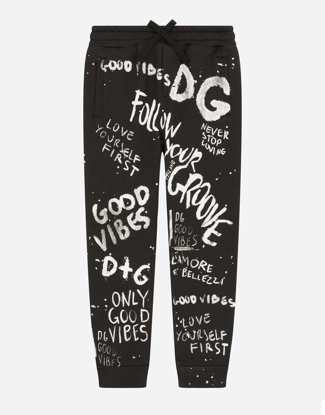 Jersey jogging pants with graffiti print in Black