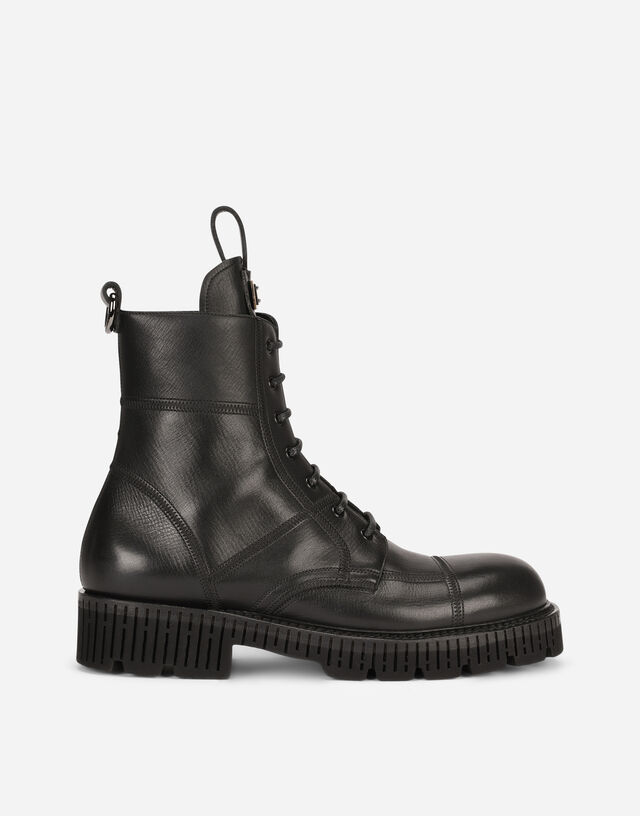 Boarded calfskin boots with extra-light sole in Black