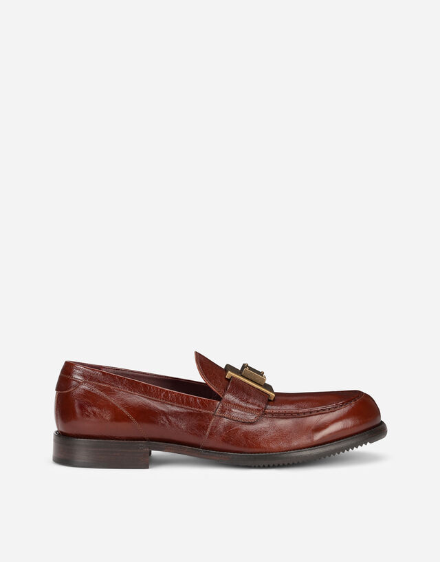 Mino calfskin loafers with branded plate in Brown