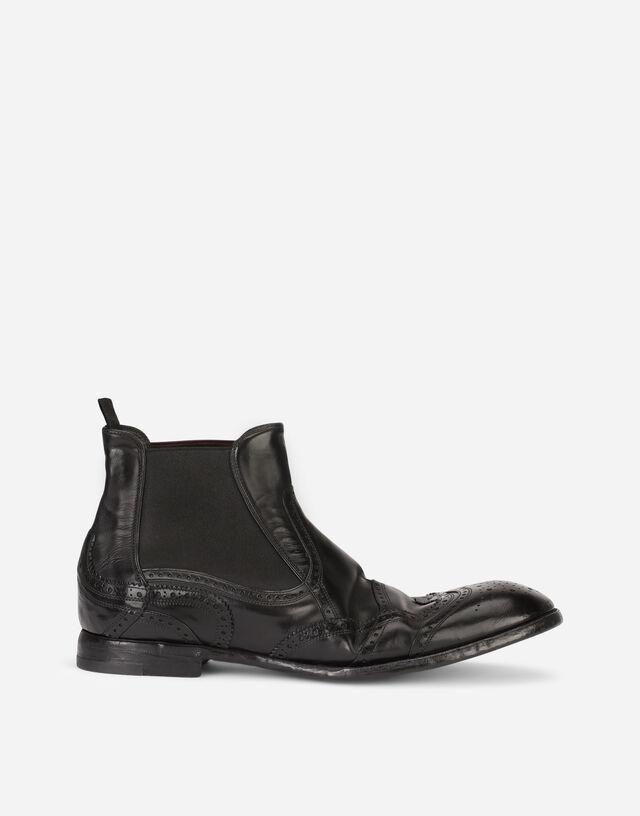 Dip-coated calfskin boots in Black