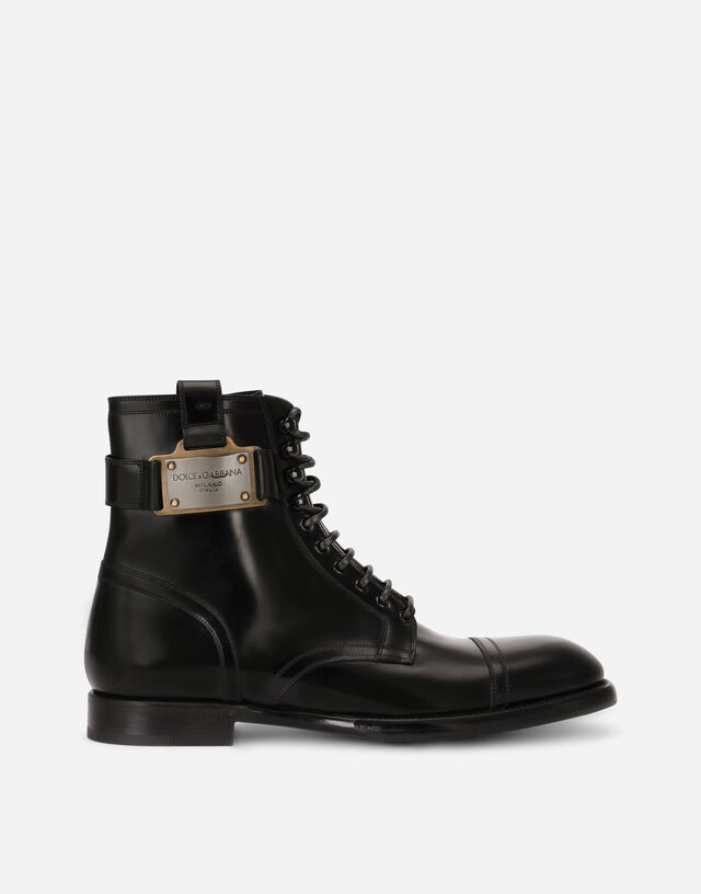 Brushed calfskin boots with branded plate in Black